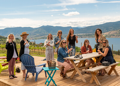 Group of Ladies Enjoying Wine on Patio at Origin Winery in Naramata Boutique